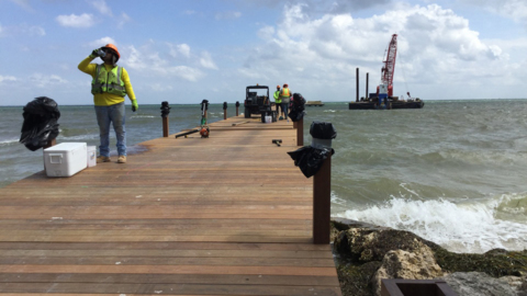 Divers inspect damage a barge did to new Anna Maria City Pier. Here's when it might open