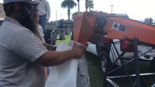 With newly purchased equipment, residents can fill sandbags in seconds
