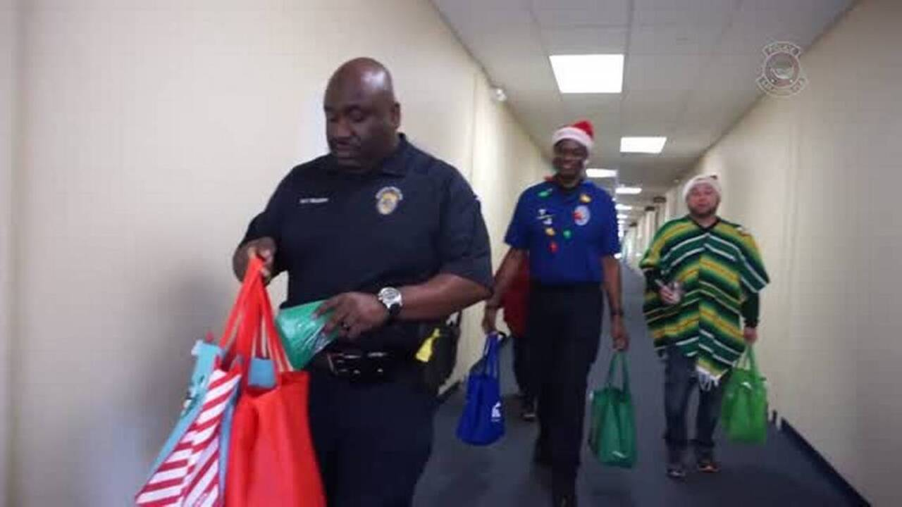 Sarasota police, volunteers hand out holiday stockings at
