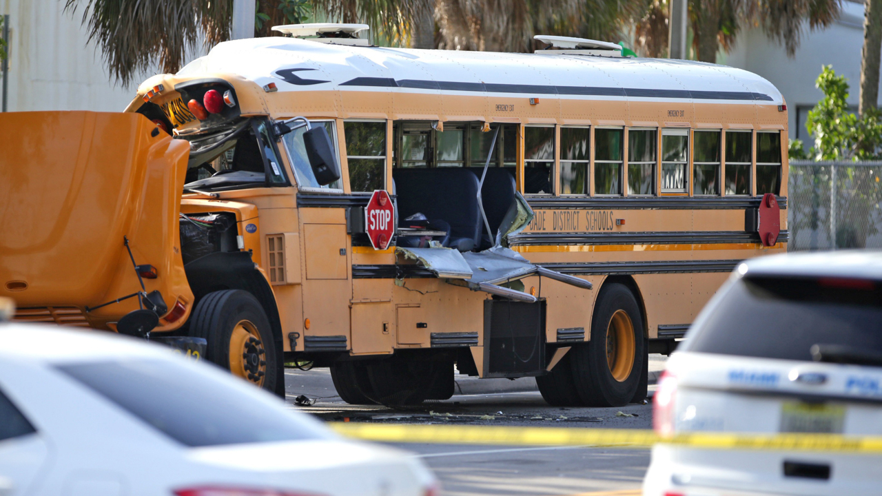Trapped aide rescued from wrecked school bus following Miami crash