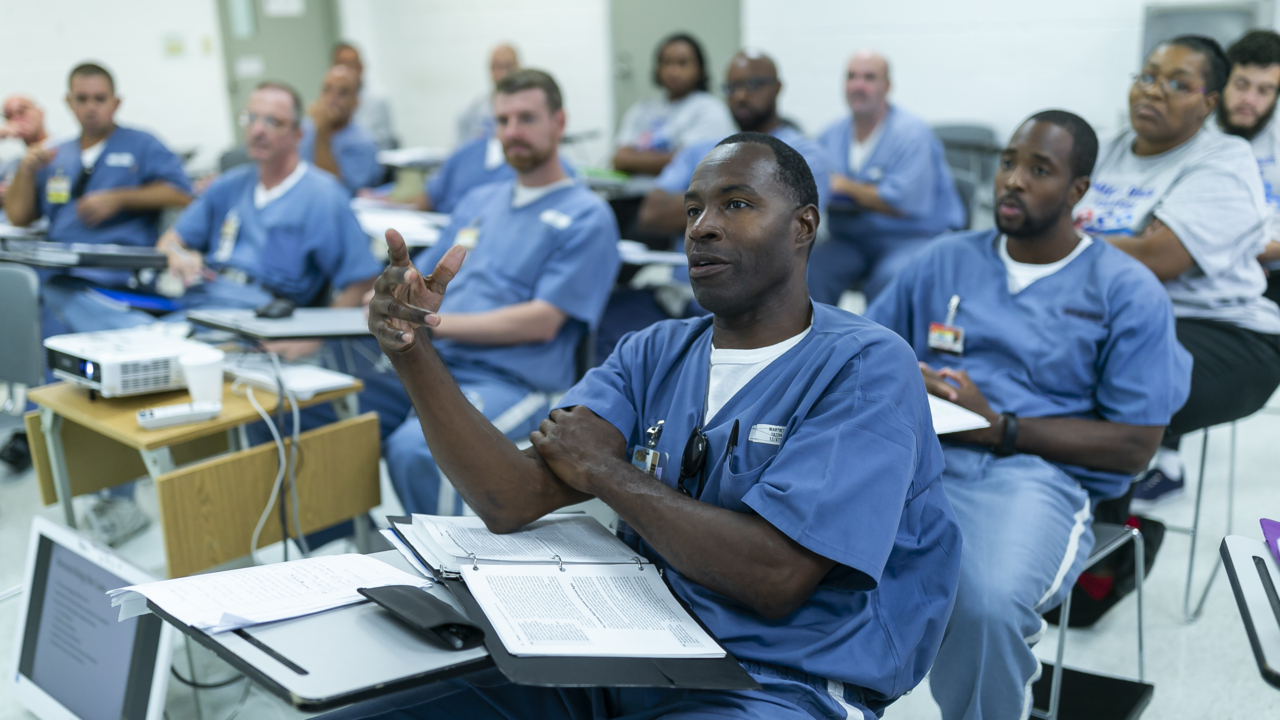 Miami Dade College is hosting classes behind bars. Inmates get the best grades.