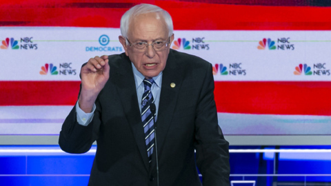 Bernie Sanders promises to tax and target corporations, but avoids the details