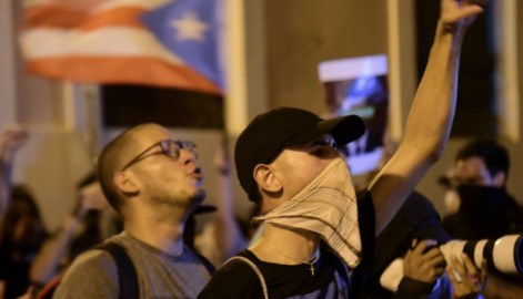 Amid arrests of island officials, Puerto Rico governor apologizes for scandal of his own