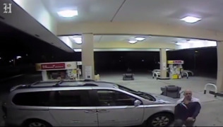 Gas Station robbery suspect goes to and from his car