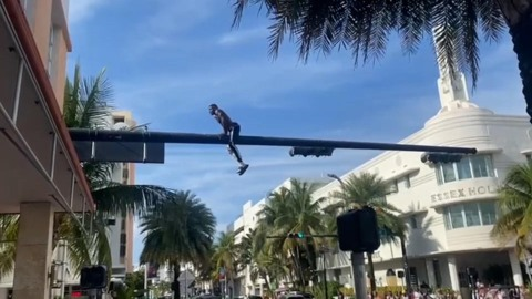 Man arrested for climbing atop traffic pole in Miami Beach Friday, causing disturbance