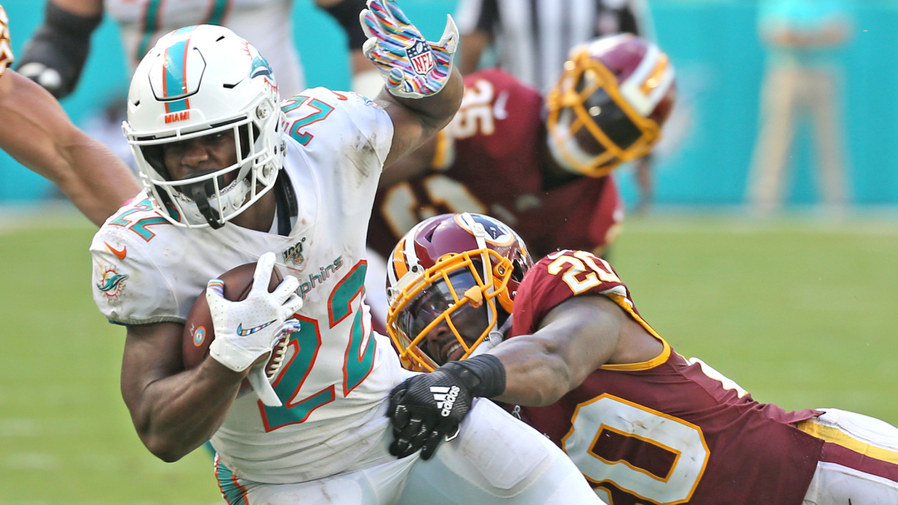 Mark Walton has earned more touches for the Dolphins. Here's what his coaches had to say.