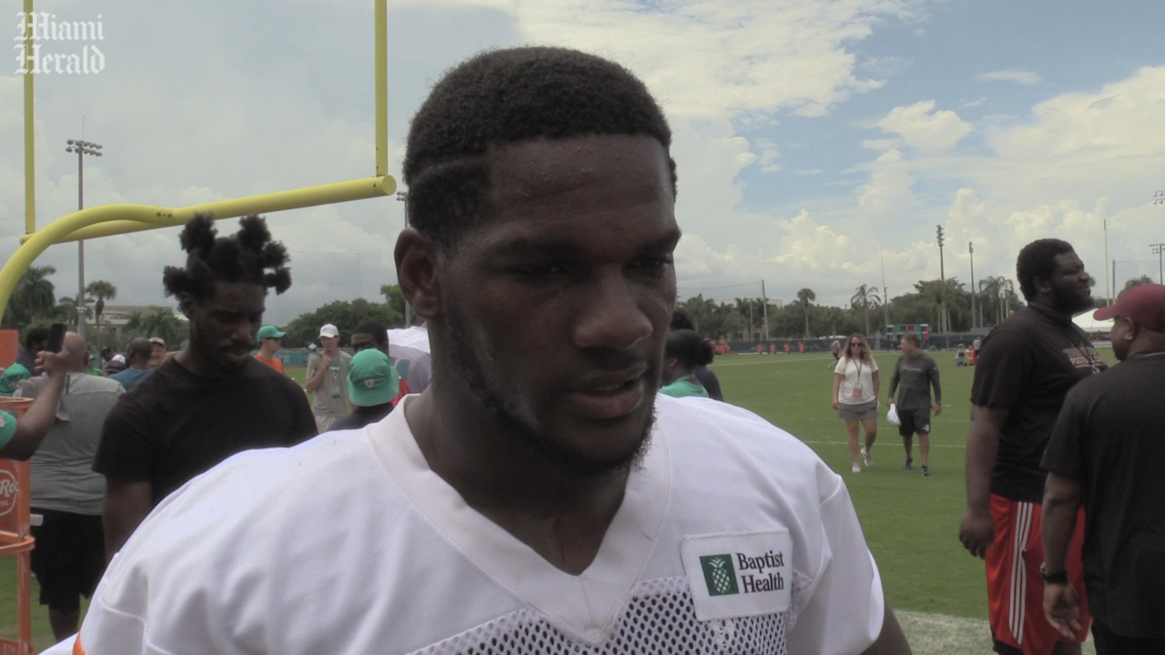 Kendrick Norton surprises former Dolphins teammates at practice after arm amputation