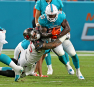 Miami Dolphins QB Ryan Tannehill is more confident with rookie RB Kalen Ballage after Tannehill ejected him from the huddle