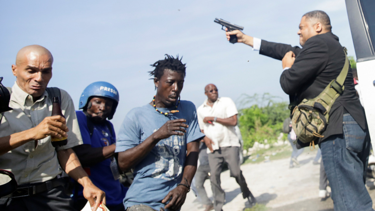 Haitian lawmaker fires gun outside senate, wounds AP photographer and security agent