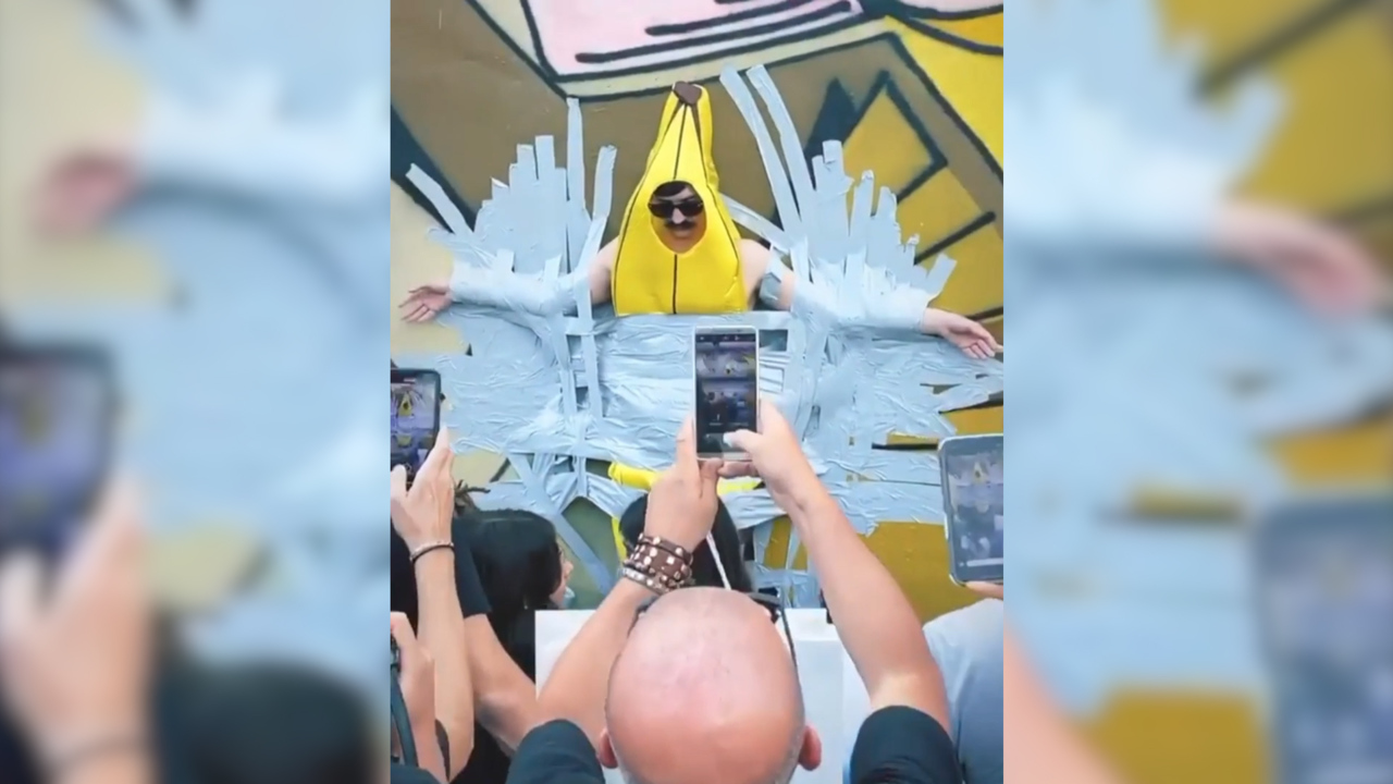Man in banana costume taped to wall in Wynwood, last day of
