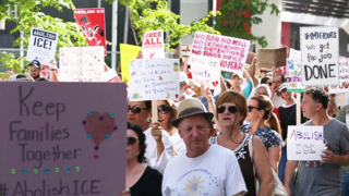 Activists march to Miami's Freedom Tower to protest the separation of immigrant families