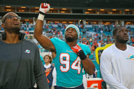 Robert Quinn protests during national anthem