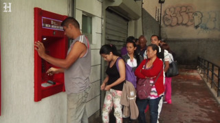 Venezuelans flock to banks, ATMs after launch of new currency
