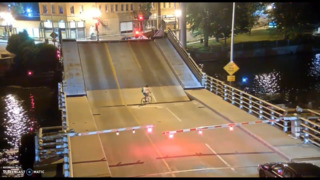 Bicyclist ignores safety signs, falls into drawbridge gap
