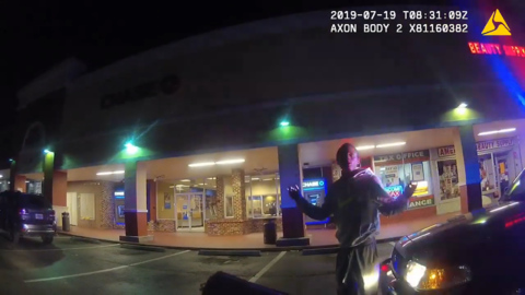 Video shows officer try to stop driver from fleeing scene in car. He came up limping.