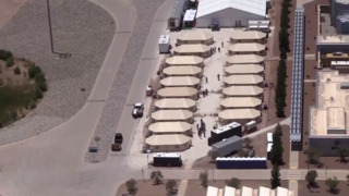 Aerial view of tent cities along US-Mexico border housing unaccompanied immigrant children in Texas