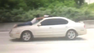Shocking video shows Florida man clinging to car on I-95