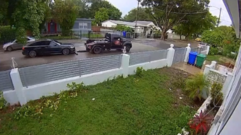 Watch: Tow truck driver tries to tow moving car