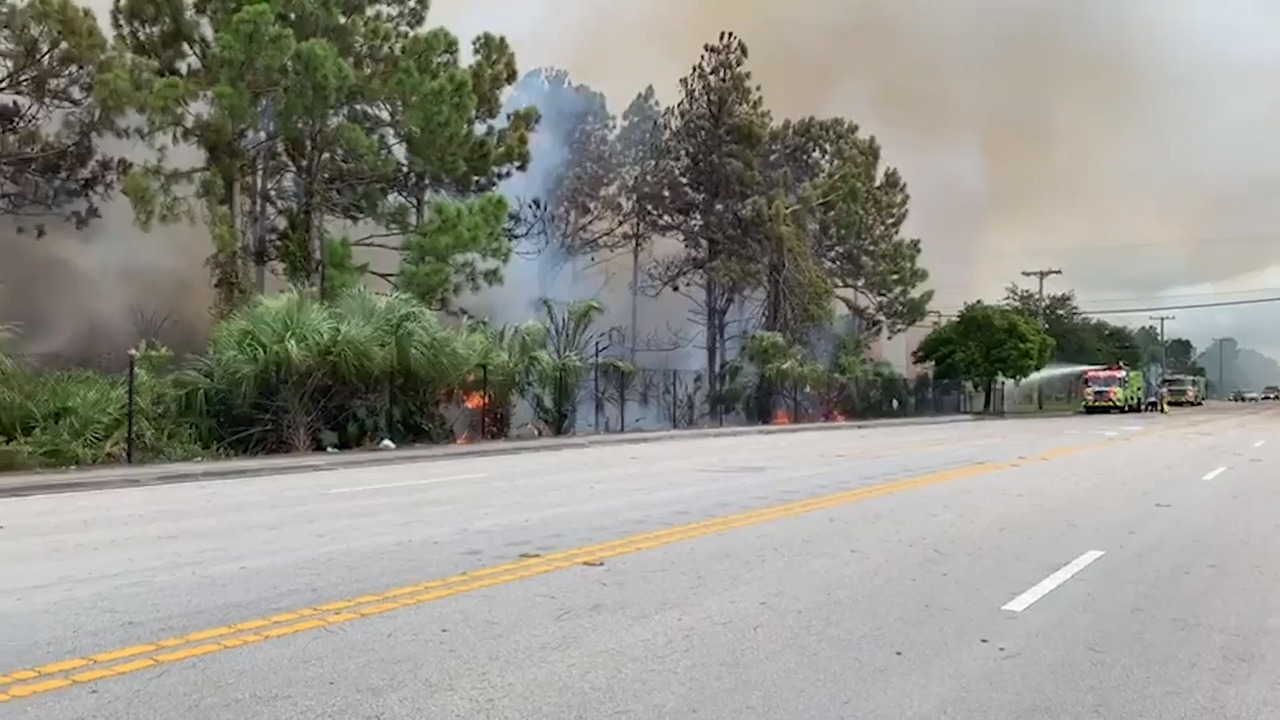 'We almost died!' Video shows onlookers fleeing from brush fire before it engulfs cars