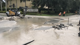 AT&T workers open sinkhole outside gated South Florida community