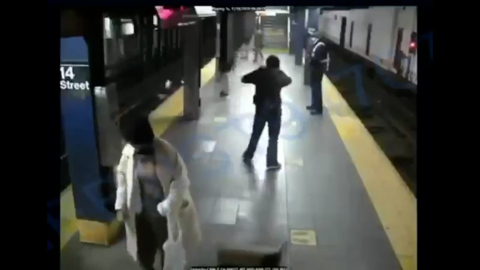 Woman survives after being pushed in front of NY subway train