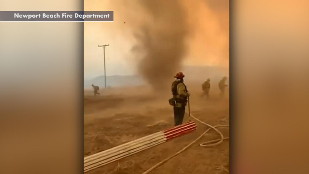 Fast-spinning dust devils form as firefighters battle blaze in California