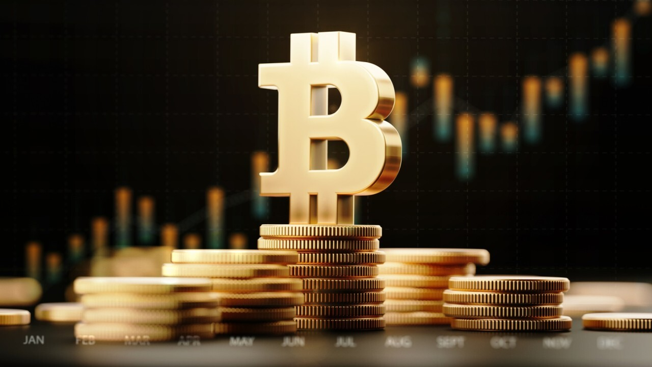 Bitcoin tops $1T for first time amid cryptocurrency surge