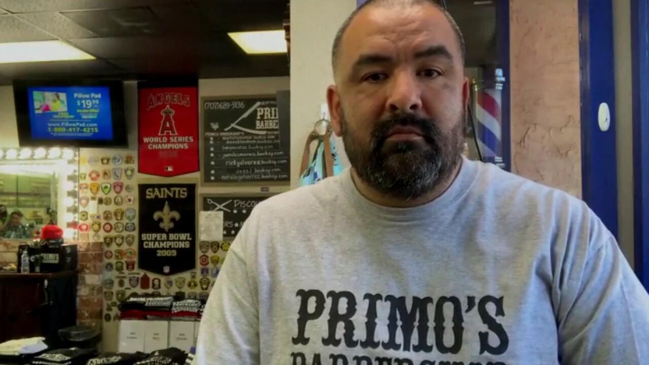 California barbershop owner defies lockdown, opens store