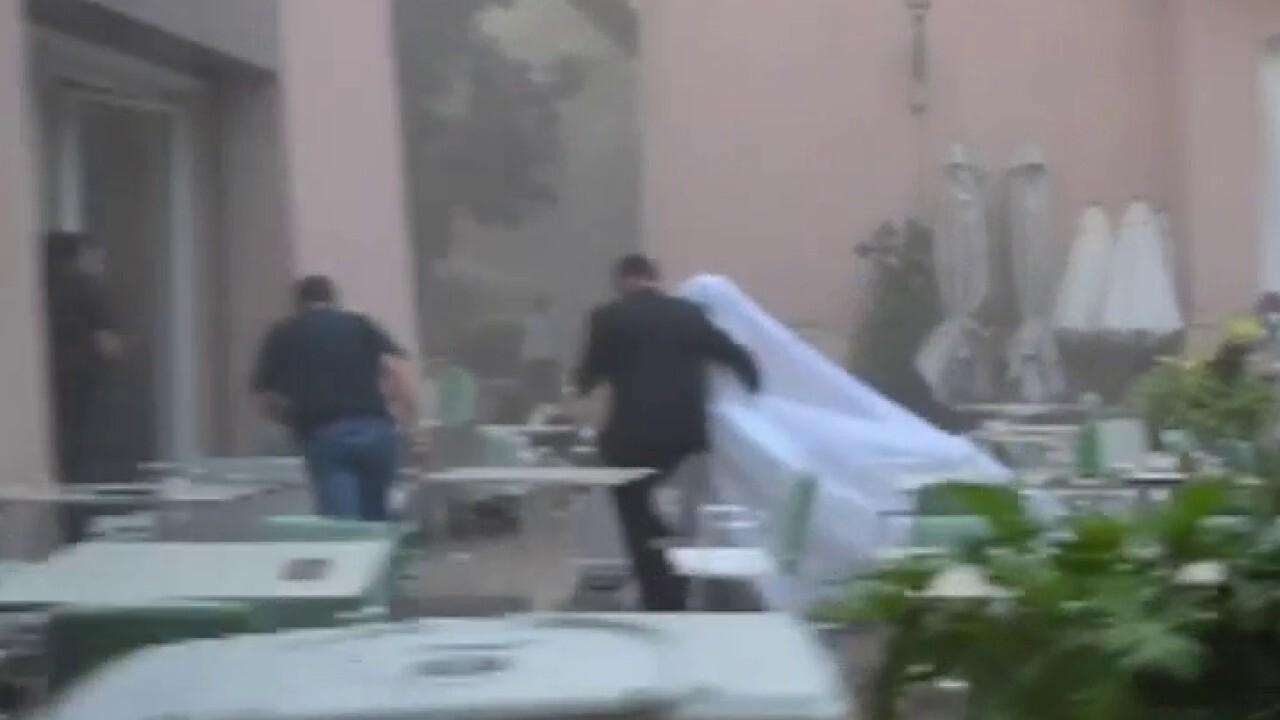 Raw video: Beirut blast interrupts bride's photoshoot