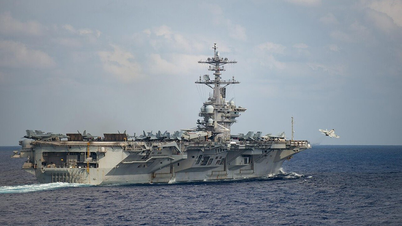 USS Theodore Roosevelt returning to sea as China...