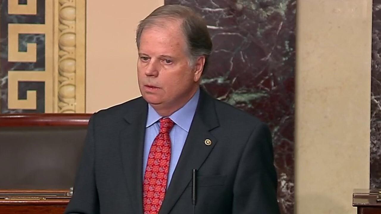 Sen. Doug Jones says he will vote to convict President Trump on both articles of impeachment