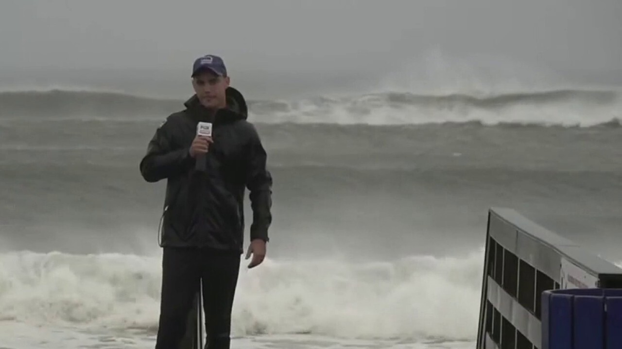 Ten-foot waves on Long Island beaches as tropical storm Henri rolls in