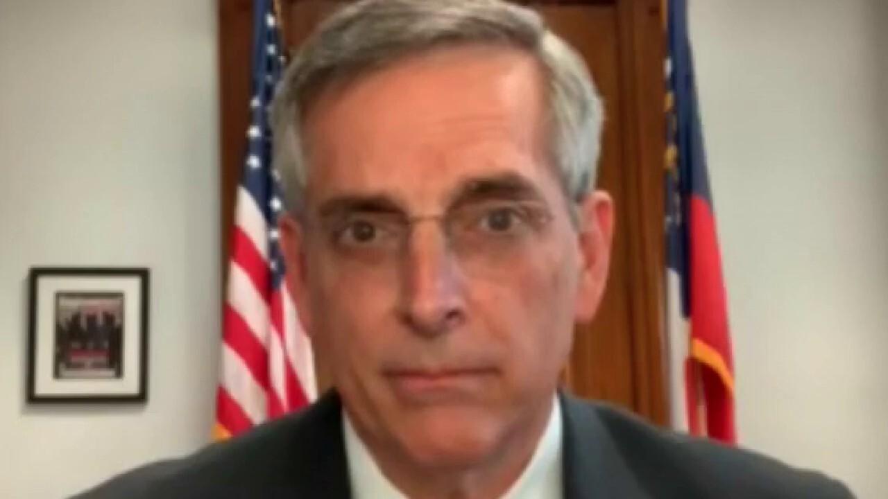 Ga. Secretary of State Raffensperger demands apology from Perdue