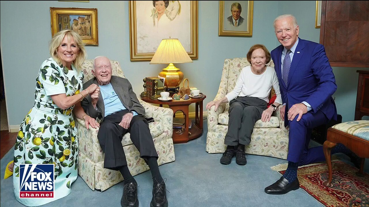 Biden goes maskless with Carters, but continues to wear it outside