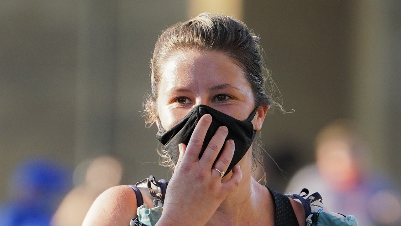 Some US cities reinstate mask mandates