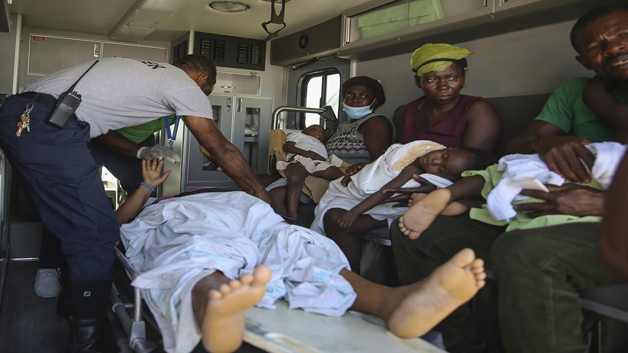 Haiti earthquake victims overwhelm hospitals as death toll approaches 2,000