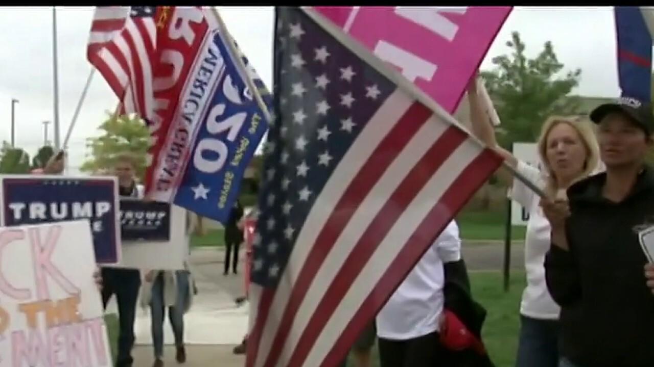 Watch: Trump supporters crash a Biden event in Michigan