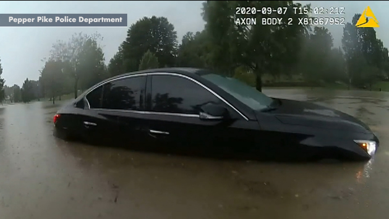 Police officer in Ohio rescues motorist trapped in floodwater