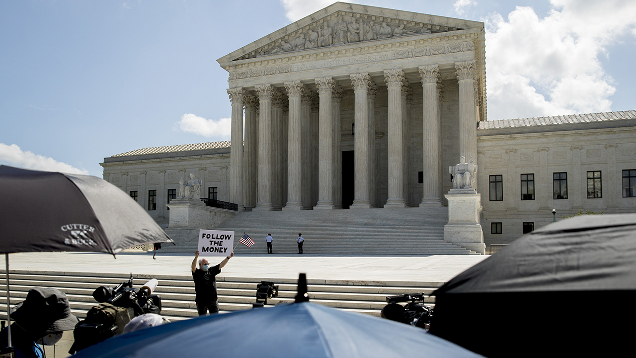 Supreme Court keeps in place Florida law requiring felons to pay fees before voting