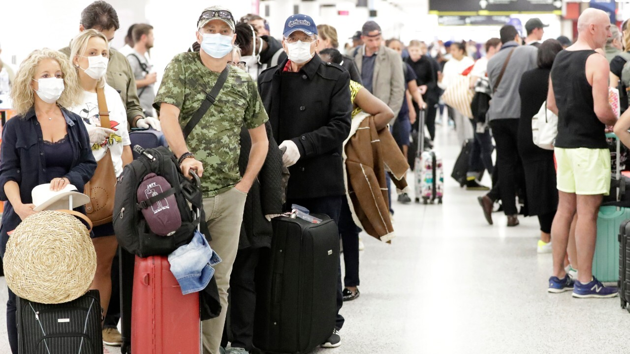 Chaos at US airports as Americans return home amid travel restrictions