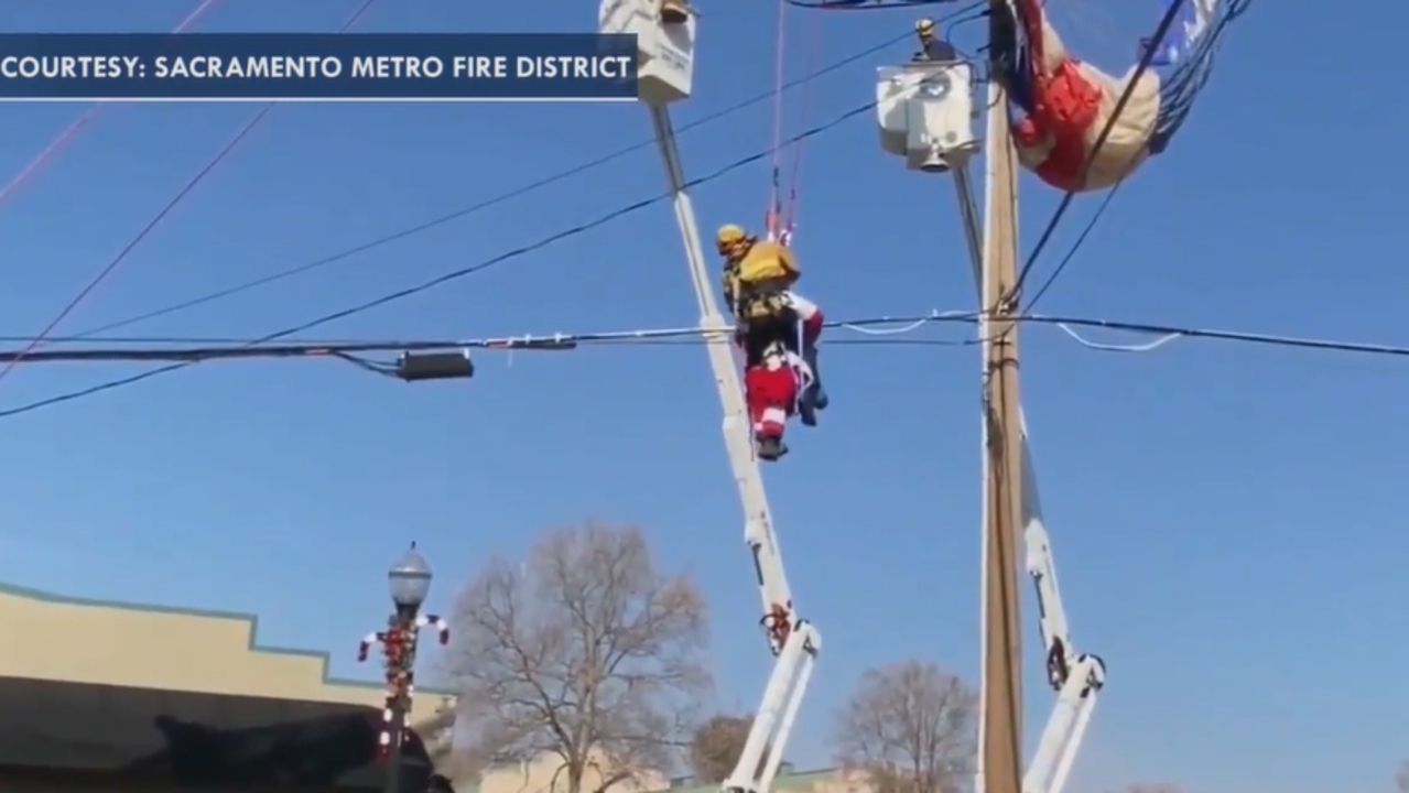 Paragliding Santa in California rescued after getting entangled in powerlines