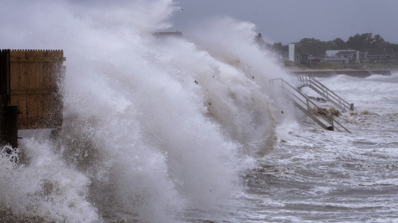 Henri lashes New England, power outages likely