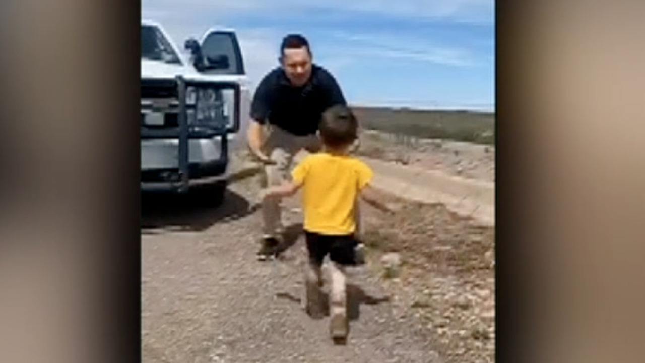 Raw video: Child runs to greet his father after weeks spent apart due to coronavirus