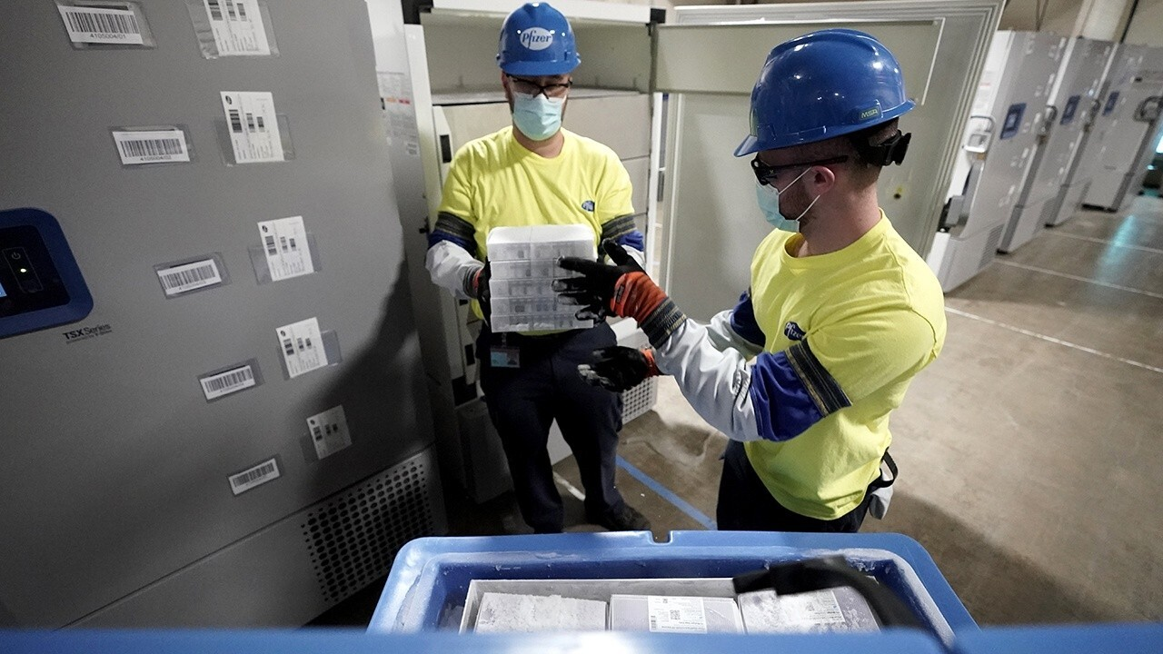 The first shipment of the Pfizer coronavirus vaccine is loaded at the Kalamazoo, Michigan facility.