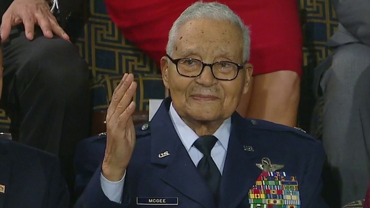 President Trump salutes one of the last surviving Tuskegee Airmen