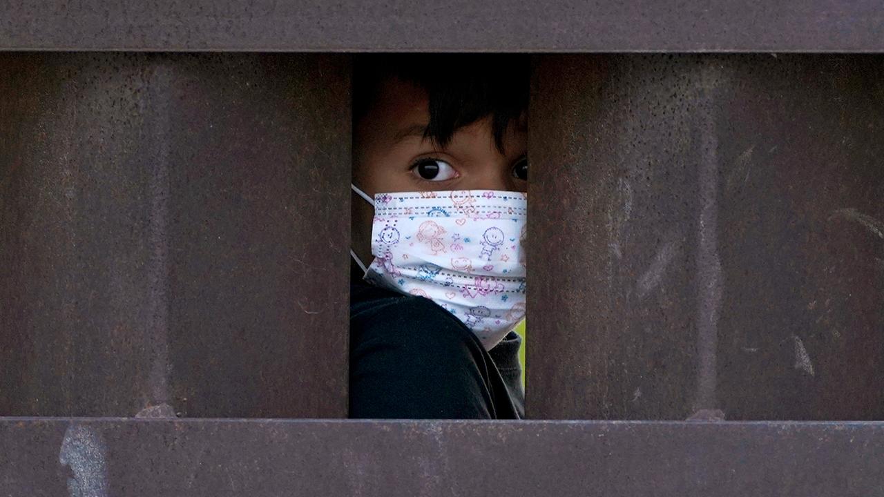 Unaccompanied migrant children in US custody tops record high 20,000