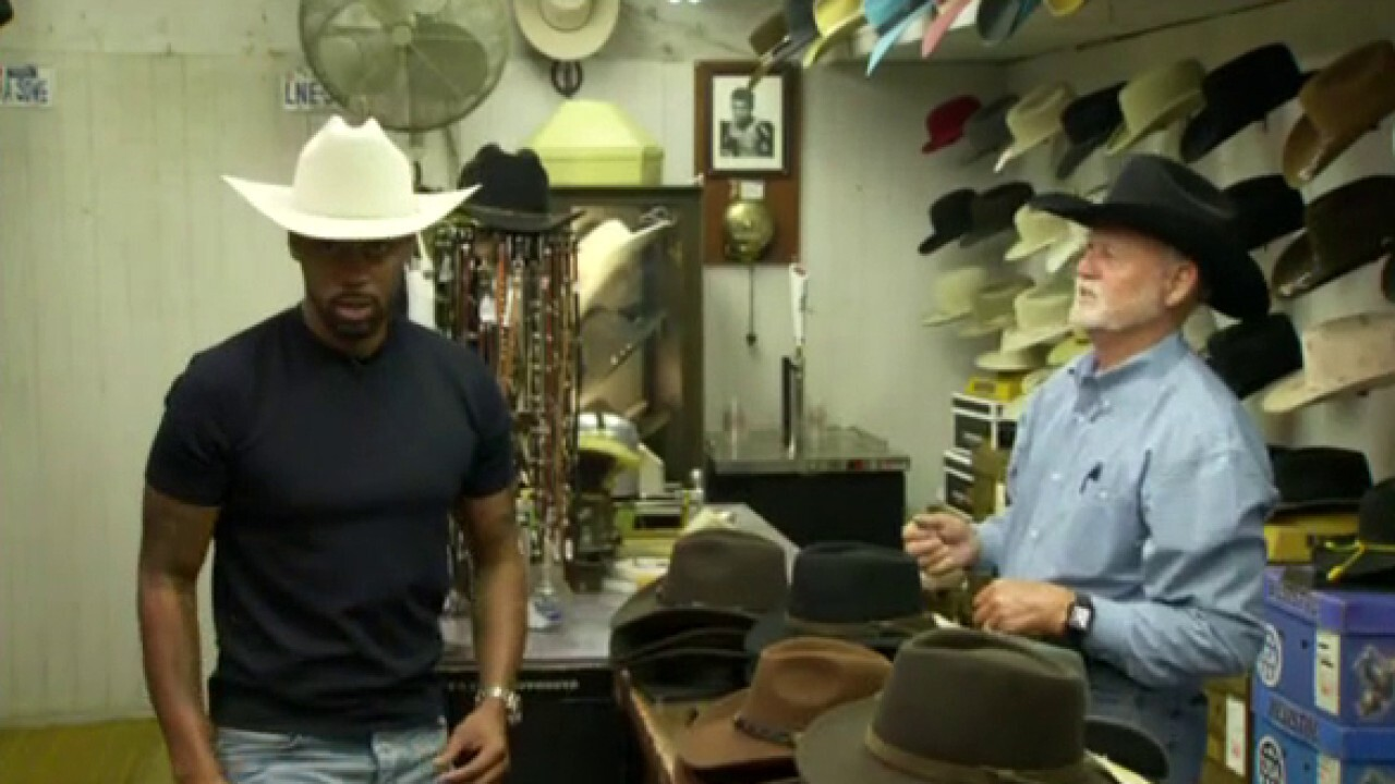 Lawrence Jones finds his perfect cowboy hat at the Texas State Fair