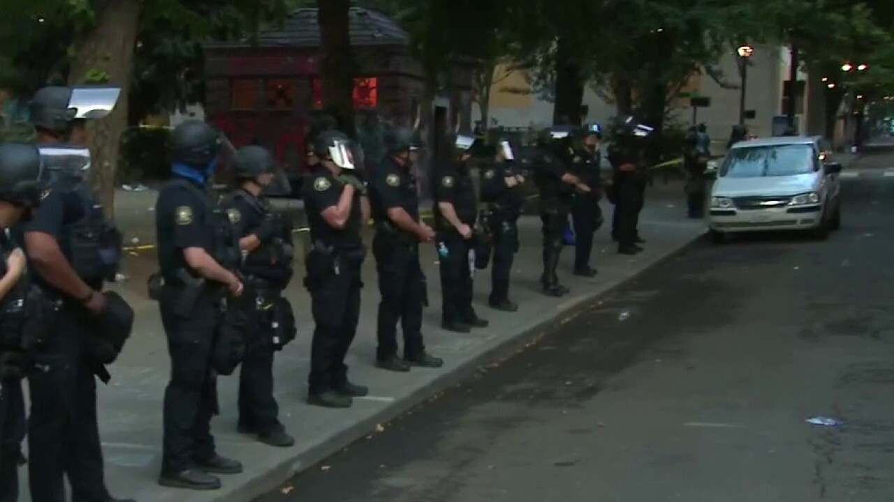 Portland police clear protesters out of park near federal courthouse