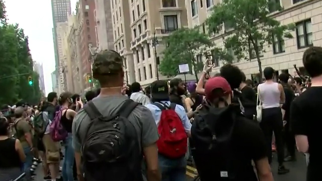 Protesters march through NYC streets despite curfew