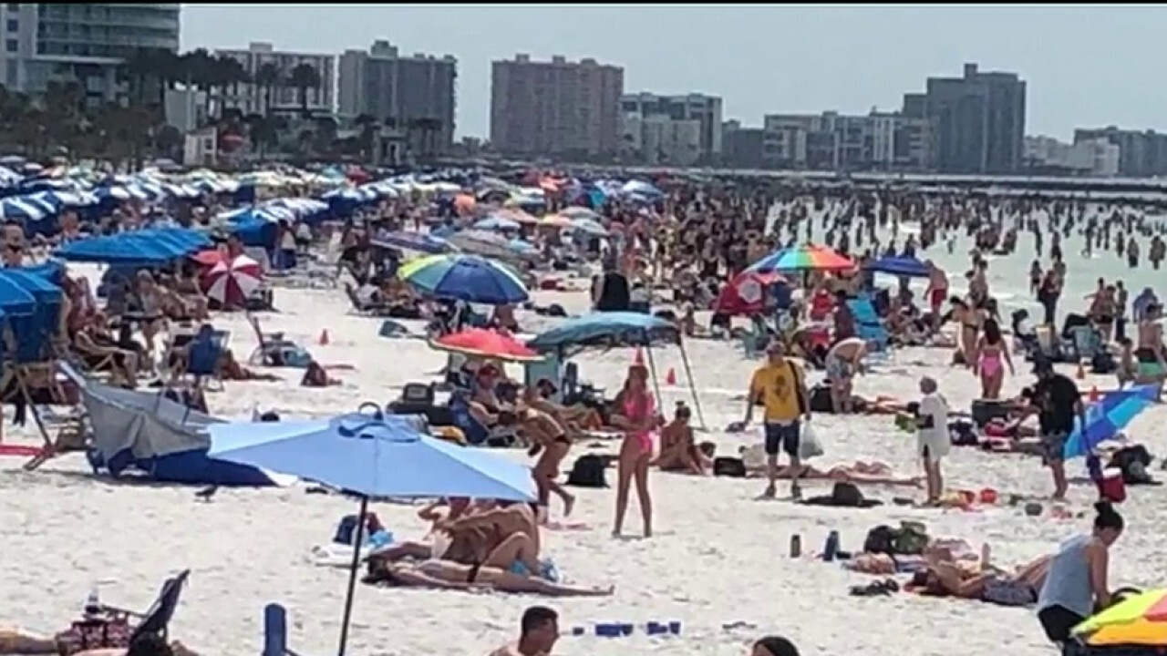 Spring breakers crowd Florida beach despite calls for social distancing